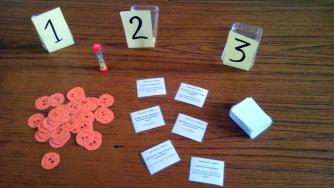 1.- Tarjetas preguntas, balones-puntos, reloj